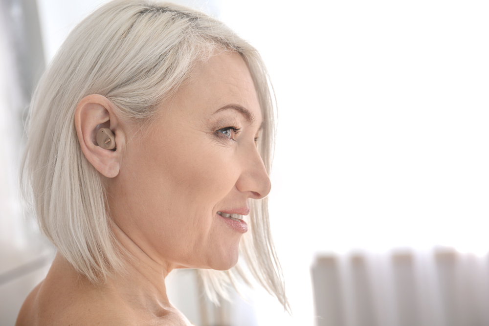 Mature,Woman,With,Hearing,Aid,Indoors
