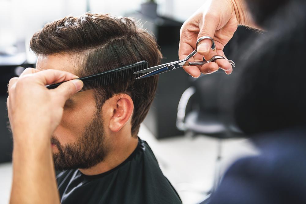 Barber,Using,Scissors,And,Comb