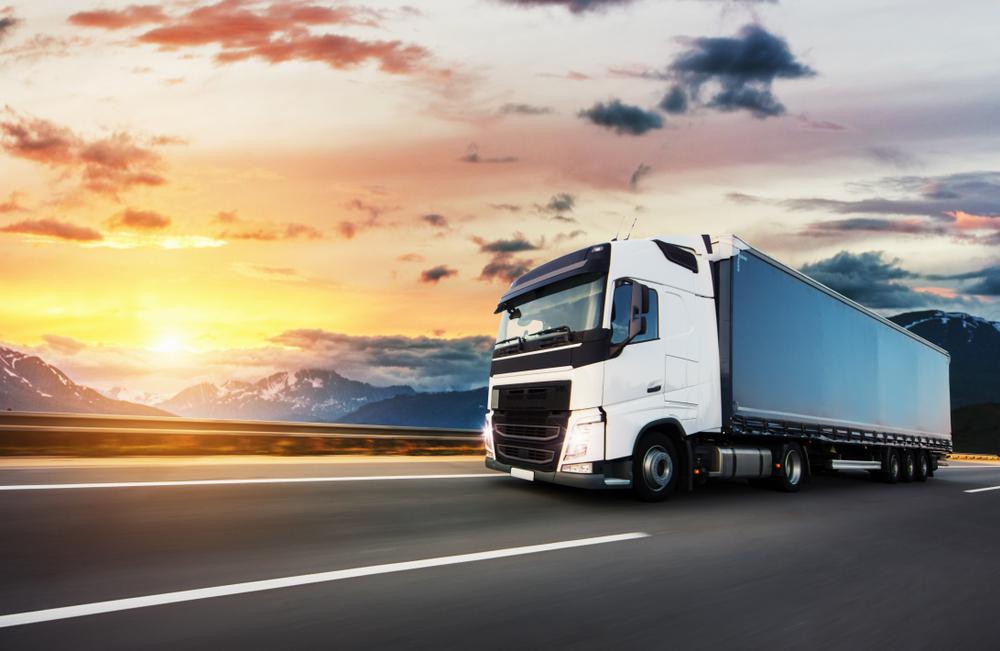 European,Truck,Vehicle,On,Motorway,With,Dramatic,Sunset,Light.,Cargo